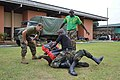 U.S. Marine Corps Sgt. Seth Cornfield, left, assigned to the Military Sealift Command-chartered high speed vessel Swift (HSV-2), encourages a Cameroonian navy commando as he executes an elbow strike drill 120828-F-AM367-092.jpg