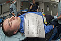 U.S. Navy Aviation Boatswain's Mate (Handling) Airman Joshua Jones acts as a wounded victim during a mass casualty training exercise aboard the aircraft carrier USS George H.W. Bush (CVN 77) in the Atlantic 130521-N-FE409-046.jpg