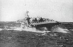 USS Lunga Point (CVE-94) rolling and pitching in heavy seas, in October 1945.jpg