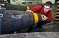 US Navy 030228-N-4953E-001 Aviation Ordnanceman 2nd Class Kyle Marcinowski conducts a quality assurance check on a GBU-31 Joint Direct Attack Munition (JDAM).jpg