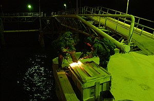 Battle of Al Faw (2003) - Naval Special Warfare operators inspect a shipping container at Mina Al Bakar Oil Terminal