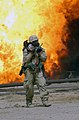 US Navy 030328-M-0000X-074 A U.S. Marine Corps Journalist assigned to the 22nd Mobile Public Affairs Detachment gets a close shot with his camera of an oil fire at the Ramaila Oilfield, Iraq.jpg