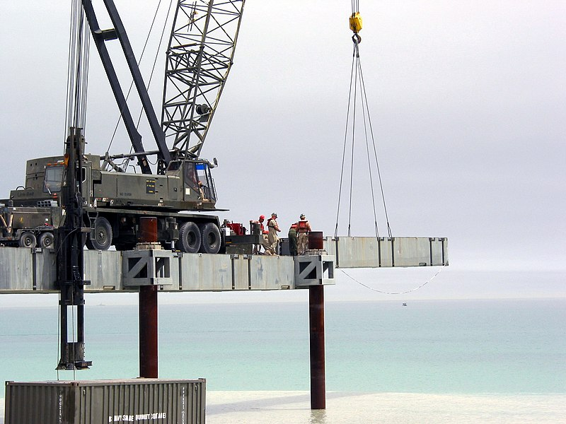 File:US Navy 030404-N-1050K-023 U.S. Navy Seabees assigned to Amphibious Construction Battalions One and Two prepare to place the next roadway section being used in the building of the Elevated Causeway System-Modular (ELCAS (M)) st.jpg