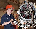 US Navy 030501-N-6484C-002 Aviation Machinist Mate Airman Melissa Gibbs works on a new power section of a engine from a C-2 Greyhound aircraft.jpg