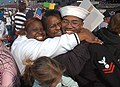 US Navy 031105-N-6633C-001 Aviation Electronics Technician 2nd Class Freeman Frazier gets a Mommy Sandwich double hug.jpg