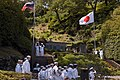 US Navy 040515-N-1194D-003 Sailors render hand salutes and the U.S. Seventh Fleet Band stands at attention while Japan Maritime Self Defense Force Sailors raise the National Ensign.jpg