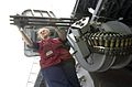 US Navy 040809-N-9293K-039 A sailor assigned to the Deck Department aboard the aircraft carrier USS Abraham Lincoln (CVN 72) polishes the barrel of a Close-in Weapons System.jpg