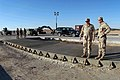 US Navy 041125-N-5386H-220 Commander, Naval Reserve Force, Vice Adm. John G. Cotton inspects a filled-in crater on a runway with Naval Mobile Construction Battalion Two Three (NMCB-23) Project Officer, Lt.j.g. Todd McNamara.jpg