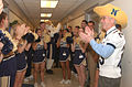 US Navy 041202-N-2568S-002 Secretary of the Navy Gordon England (SECNAV), U.S. Naval Academy cheerleaders, and mascot Bill the Goat kick off a pep-rally in the halls of the Pentagon.jpg
