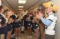 US Navy 041202-N-2568S-002 Secretary of the Navy Gordon England (SECNAV), U.S. Naval Academy cheerleaders, and mascot Bill the Goat kick off a pep-rally in the halls of the Pentagon.jpg