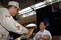 US Navy 041209-N-7469S-002 A Sailor receives an autograph from NASCAR driver John Andretti on board Naval Support Activity (NSA) Bahrain.jpg