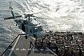 US Navy 050120-N-3372S-024 An MH-60S Knighthawk helicopter hovers over the flight deck of the Military Sealift Command (MSC) fleet replenishment oiler USNS Tippecanoe (T-AO 199).jpg