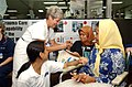 US Navy 050314-N-6665R-022 A Project HOPE volunteer says good-bye and gives a ring to an elderly Indonesian patient.jpg