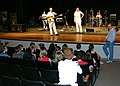 "US Navy 050509-N-2599L-004 Musician 3rd Class Sandra Taylor, left, Musician 2nd Class Mike Bishop, center, and Musician 3rd Class Sarah Janiak, right, of the U.S. Navy Band ""Millennium"" work with Monarch High School.jpg"