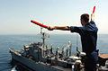 US Navy 050604-N-9446C-045 Quartermaster 2nd Class Kyle Vanduzor aboard the Nimitz-class aircraft carrier USS Carl Vinson (CVN 70), transmits a message to fast combat support ship USS Camden (AOE 2).jpg