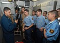 US Navy 050702-N-5373B-017 Several U.S. Naval Sea Cadets get a hands on look a M-16 assault rifle from Gunner's Mate 1st Class Whatley in the armory aboard the amphibious assault ship USS Iwo Jima (LHD 7).jpg