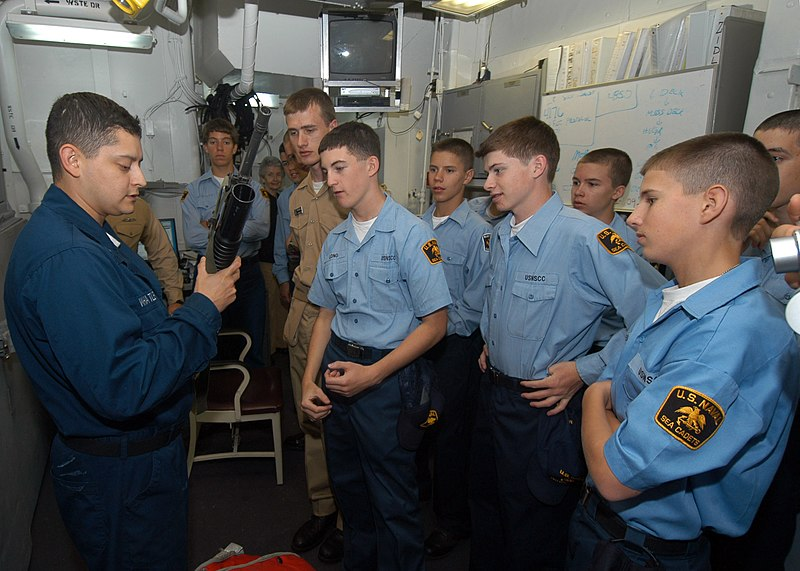 File:US Navy 050702-N-5373B-017 Several U.S. Naval Sea Cadets get a hands on look a M-16 assault rifle from Gunner's Mate 1st Class Whatley in the armory aboard the amphibious assault ship USS Iwo Jima (LHD 7).jpg