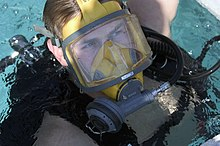 US Navy 050727-N-0295M-010 Electrician's Mate 2nd Class Shane Portton emerges out of the Navy Diver-Explosive Ordnance Disposal (EOD) dive tank exhibit at the 2005 National Scout Jamboree held at Fort A.P. Hill, Va.jpg