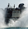 US Navy 051001-N-1722M-326 A Landing Craft, Air Cushion (LCAC), assigned to the dock landing ship USS Germantown (LSD 42), kicks up sea spray during a demonstration of its capabilities.jpg