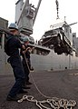 US Navy 051014-N-9563N-005 Personnel assigned to the dock landing ship USS Pearl Harbor (LSD 52) and Seabees assigned to Naval Mobile Construction Battalion Three (NMCB-3), load heavy equipment bound for Pakistan.jpg