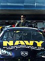 US Navy 051022-N-9769P-300 NASCAR driver David Stremme stands behind the No. 14 Navy Accelerate Your Life Dodge Charger.jpg