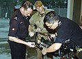US Navy 060609-N-9162R-239 Equipment Operator 1st Class Toby Griffin receives training from members of the Hong Kong Police Department's Explosive Ordnance Disposal Unit.jpg