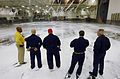 US Navy 070504-N-7883G-048 Engineering and air department Sailors observe tests of the aqueous film forming foam (AFFF) fire suppression system in hangar bay 1 on USS Kitty Hawk (CV 63).jpg