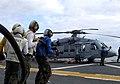 US Navy 071106-N-1786N-011 Flight deck firefighters attack a simulated fire during a drill aboard amphibious assault ship USS Tarawa (LHA 1).jpg