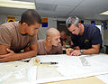 US Navy 080729-N-6552M-035 Special Boat Operator 1st Class Zach Riley teaches students how to lay out navigational tracks on a chart.jpg