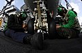 US Navy 081109-N-9928E-062 Aviation Structural Mechanic 3rd Class Luis Cardozo-Gonzalez nd Aviation Structural Mechanic 2nd Class Randy Roller replace a nose wheel tire on an E-2C Hawkeye.jpg