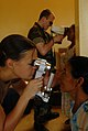 US Navy 081111-N-3595W-169 Lt. Megan Rieman and Hospital Corpsman 3rd Class Richard Utley give eye exams to patients at Kumaka District Hospital.jpg