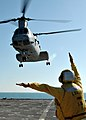 US Navy 090109-N-9134V-029 Boatswain's Mate 2nd Class Joshua Hayes, from Jasper, Ala., directs a CH-46E helicopter from Marine Medium Helicopter Squadron (HMM) 264 aboard the amphibious dock landing ship USS Carter Hall (LSD 50.jpg