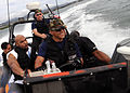 US Navy 090204-N-9758L-135 National Football League Pro Bowl players Tennessee Titans Chris Hope and New York Giants Justin Tuck shouts with excitement while making a sharp turn during a rigid hull inflatable boat tour.jpg
