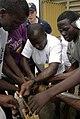 US Navy 090320-N-3316L-152 Nigerian navy members demonstrate pipe patching techniques.jpg