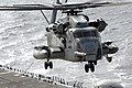 US Navy 091013-N-8878B-050 A CH-53E Super Stallion helicopter assigned to Marine Medium Helicopter Squadron (HMM) 165 takes off from the amphibious assault ship USS Makin Island (LHD 8).jpg