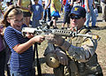 US Navy 091107-N-6214F-008 A Navy SEAL shows a child an M4 carbine during the 2009 Veterans Day Ceremony.jpg