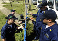 US Navy 091108-N-7280V-644 Sailors from the Arleigh Burke-class guided-missile destroyer USS Lassen (DDG 82), amphibious command ship USS Blue Ridge (LCC 19) and embarked U.S. 7th Fleet staff paint a fence at To Hien Thanh Elem.jpg