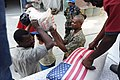 US Navy 100202-N-8288S-322 Haitian citizens receive bags of rice.jpg