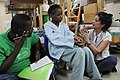 US Navy 100208-N-4995K-105 A Haitian girl, displaced by a 7.0 magnitude earthquake in Haiti Jan. 12, is interviewed to assess her needs as a displaced child.jpg