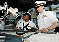 US Navy 100310-N-6676S-044 Quartermaster 2nd Class Kasey Henderson, left, Lt. j.g. Dan Ciullo plot the course for the amphibious dock landing ship USS Gunston Hall (LSD 44).jpg