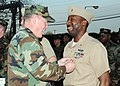US Navy 100318-N-5373B-007 Capt. Michael L. Jordan, commander of Expeditionary Combat Readiness Center Little Creek, Va., presents the Bronze Star medal to Chief Information Systems Technician Thornell Mayo Jr.jpg