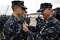 US Navy 100409-N-9818V-617 Master Chief Petty Officer of the Navy (MCPON) Rick West pins the Enlisted Submarine Warfare pin on a Sailor.jpg