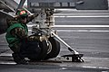 US Navy 100426-N-5749W-344 Aviation Boatswain's Mate (Equipment) 3rd Class Jesus Garcia, from Uvalde, Texas, guides an aircraft into the catapult shuttle aboard the aircraft carrier USS Abraham Lincoln (CVN 72).jpg