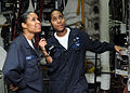 US Navy 100629-N-5215E-029 Machinist's Mate Firemen Sonia Philip, left, and Sophia Philip report the status of the ship's ^2 boiler during the Board of Inspection and Survey.jpg