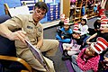 US Navy 110302-N-HW977-194 Capt. Jay Kadowaki reads to students at Clara Barton Elementary School during a Read Across America event.jpg