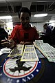 US Navy 110307-N-OY799-508 Aviation Ordnanceman Airman Jaessica Hughes, from Tuscaloosa, Ala., plays bingo on the mess decks during a ship-wide bin.jpg