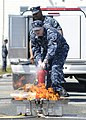 US Navy 110520-N-ZK021-006 Sailors learn to properly use a fire extinguisher during a safety fair at Naval Air Station Whidbey Island.jpg