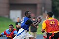 US Navy 110802-N-GS507-523 Chief Information Systems Technician Otis Frazier, center, runs for a first down during the annual flag football game be.jpg
