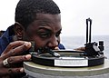 US Navy 111003-N-WJ771-014 Chief Quartermaster Raymond E. Smith uses an azimuth circle from the port bridge wing of the forward-deployed amphibious.jpg