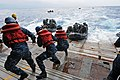 US Navy 111006-N-MW330-656 Sailors assist Marines assigned to the 31st Marine Expeditionary Unit (31st MEU) in combat rubber reconnaissance crafts.jpg
